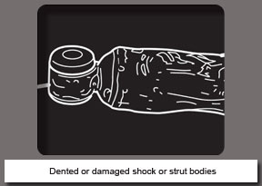 Dented or damaged shock or strut bodies